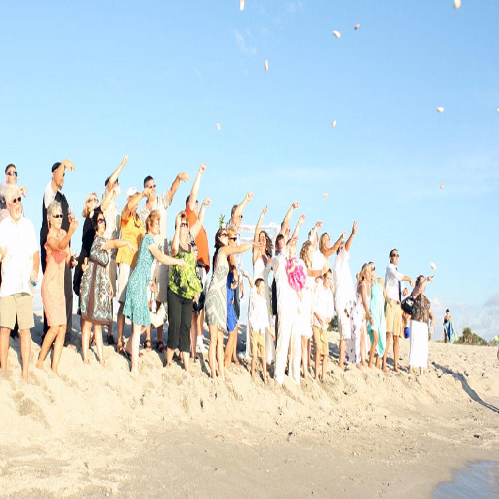 Siesta Key Beach Wedding Ceremony: 17-blessing_shell_ceremony_tossing_them_siesta_key
