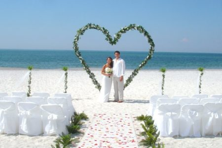Heart shaped arch for beach wedding in florida | standing hart in the sand