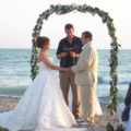 wedding ceremony on the arch of love on venice beach florida | florida sun weddings