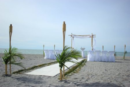 Forever Yours Natural Bamboo in White beach wedding package with rode petals and fresh greenery | florida sun weddings