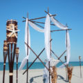 Forever Yours chocolate black bamboo in white and brown beach wedding package with starfish and kissing balls | florida sun weddings