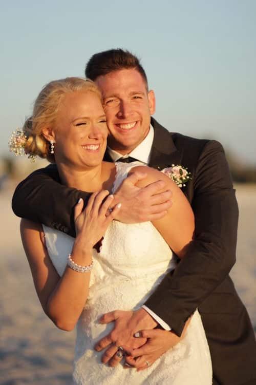 Kristen and Alex newlyweds on Longboat Key Florida   floridasunweddings.com