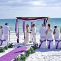 ocean waves purple beach wedding package with purple carpet runner | floridasunweddings.com