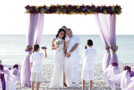 bamboo trellis with flowing purple organza fabric | wedding ceremony under siesta dream, florida beach