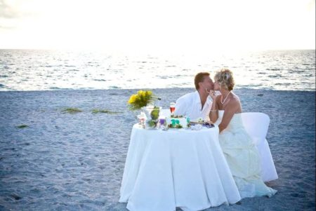 table for two with cake and champagne on the beach | romantic beach wedding in florida