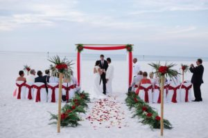 tropical breeze beach wedding package in white and red | florida sun weddings