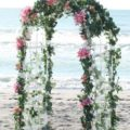 traditional arch with pink flowers for beach weddings | florida sun weddings