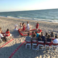 wedding ceremony in a rose petal heart in the sand | florida beach wedding