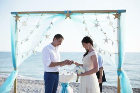 sea stars beach wedding package in white aqua | floridasunweddings.com