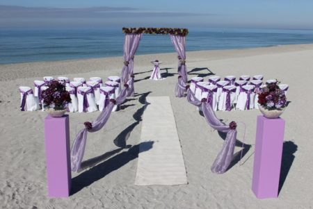 purple bamboo trellis for beach wedding in florida | floridasunweddings.com