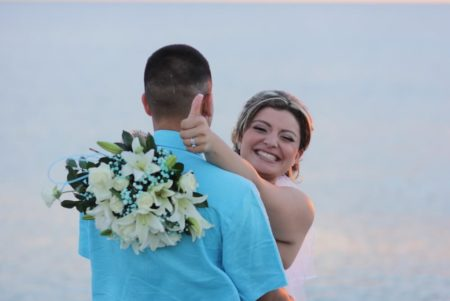 bride gives thumbs up and winks by the ocean   Florida Beach Wedding