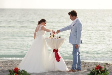 bride and groom married by the ocean | sand ceremony | florida sun weddings