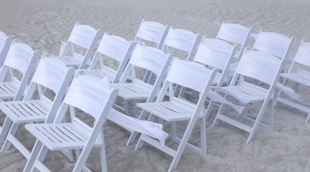 white resin chairs and sashes | beach wedding in florida