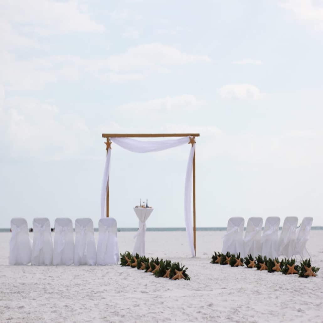 Siesta Key Beach Wedding Ceremony: Intimate Breeze In White With Starfish