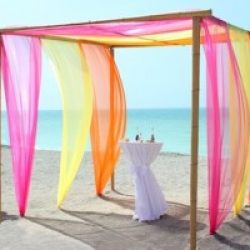 Beach Wedding Florida Bamboo Trellis Orange Pink Yellow