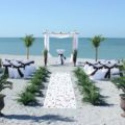 Florida sun weddings white chuppah with white chairs and brown sashes | Florida Beach Wedding