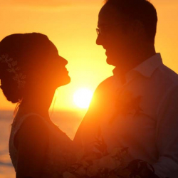 Sunset Silhouette Photo of Bride and Groom at Florida Gulf Coast Wedding Ceremony