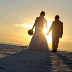 Bride and Groom Sunset Silhouette photo | Florida Beach Wedding Photography by Cristina Gebel