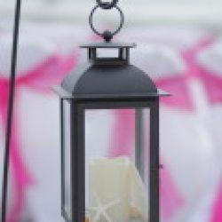 black lantern on shepherd's hook for whispering sands beach wedding package | florida | floridasunweddings.com