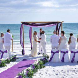 ocean waves purple beach wedding package with purple carpet runner | floridasunweddings.com