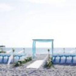 ocean waves aqua beach wedding package with white carpet runner | floridasunweddings.com