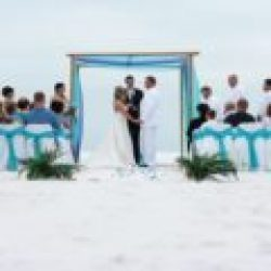 whispering sands beach wedding package in aqua and purple ceremony | florida beach weddings