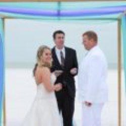 bride and groom under whispering sands beach weddings package | florida sun weddings
