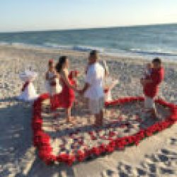 beach wedding on siesta kay florida | heart of rose petals in the sand