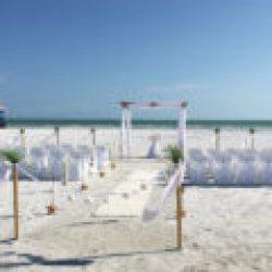 ocean waves white beach wedding package with starfish | floridasunweddings.com