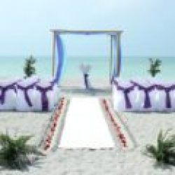 whispering sands beach wedding package in aqua and purple | florida beach weddings