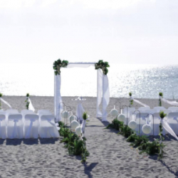 White Elegance beach wedding package with kissing balls