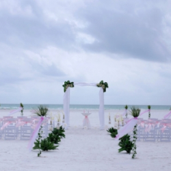 White Elegance beach wedding package with pink sashes